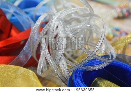 Colorful tape, ribbon, lace, band, webbing, string for decoration on the table. Decorations for the celebration, party, holiday, wedding. Hand made for design, decor