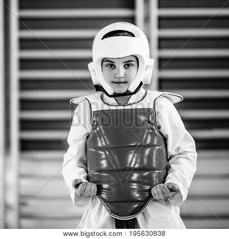 Portrait of Tae Kwon Do Boy on training indoors black and white image