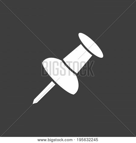 Isolated white pushpin on a dark background