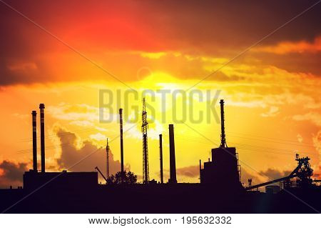 Silhouette of chemical factory at sunset. Industry concept.