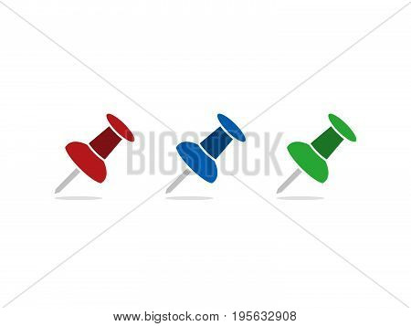 Four colored pushpin on a white background