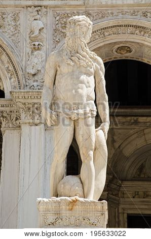 Statue of the Roman god of the sea - Neptune at the top of the Giants' Staircase to the historic Doge's Palace in Venice Italy. Sculpted by the Renaissance artist Jacopo Sansovino.