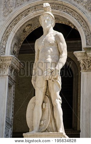 Large Renaissance statue of the Roman god of War Mars on the Giants' Staircase entrance to the historic Doge's Palace in Venice Italy. Sculpted by the artist Jacopo Sansovino.