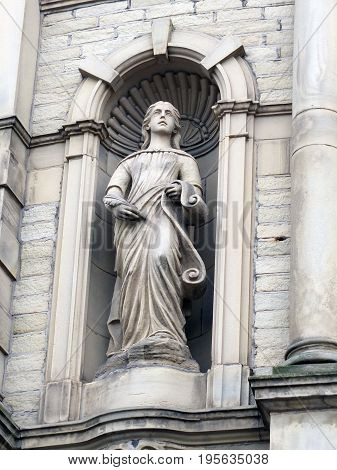 statue of a muse on a victorian theater building in Halifax England