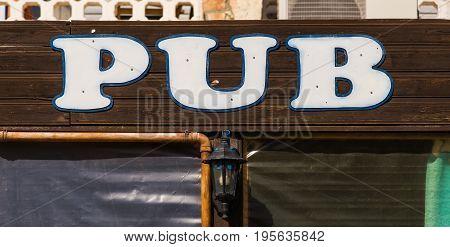 Pub Sign in Ireland in Summertime. inscription pub sign