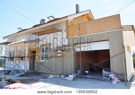 KYIV UKRAINE - JULY 18 2017: Unfinished house. Remodeling Home. House Renovation. Painting house wall and stucco plastering wall.