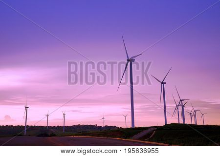 Wind turbine farm during beautiful sunset Alternative green energy for protection of nature at Khao Kho Phetchabun province Thailand