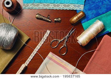 Home dressmaker concept tailor hobby still life - top view.