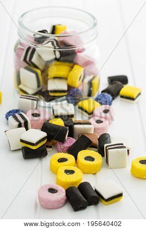 Mixed liquorice candies on kitchen table.