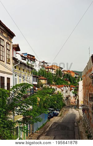 VELIKO TARNOVO BULGARIA - MAY 28 2017: Secondary street in old town with renovating buildings and damaged road surface