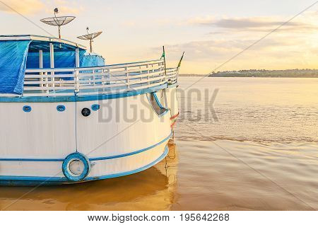 Stern Of The Boats On The Banks Of The Rio Madeira River On A Sunset