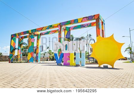 Welcome Structure At The Entrance Of The City Of Porto Velho With A Sun