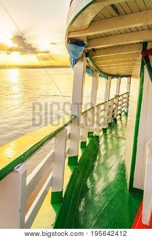 Landscape Of A Traditional And Classic Boat Ride On Rio Madeira River At Sunset