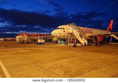 CAMPO GRANDE BRAZIL - JUNE 19 2017: Plane parked into Internacional de Campo Grande airport for maintenance and refuel at dawn.