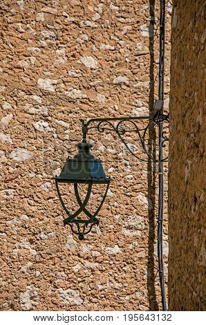 Close-up of lamp and stone walls in Saint-Paul-de-Vence, a lovely well preserved medieval hamlet near Nice. Located in Alpes-Maritimes department, Provence region, southeastern France