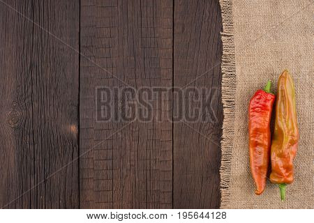 Chilli peppers on wooden background. Top view.