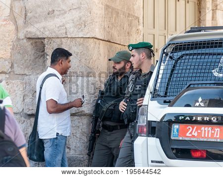 Jerusalem Israel July 14 2017 : Soldiers guard the entrance to the old city of Jerusalem and talk with the local inhabitant in Jerusalem Israel