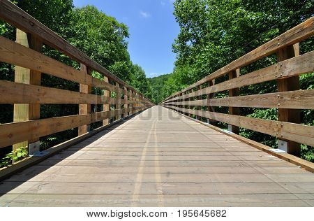 Wooden trestle bridge on the Virginia Creeper Trail in the United States, wildly popular with cyclists