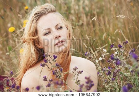 Artistic Portrait Of Freckled Woman On Natural Background