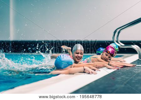 Swimming Lesson On Indoor Swimming Pool, Toned Image