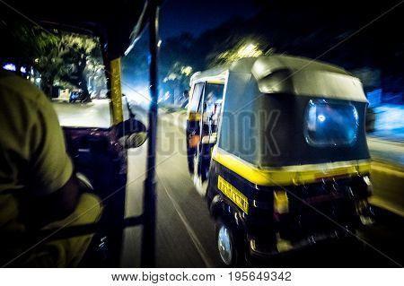 MUMBAI, INDIA - November 11 2017: A night time ride in an auto rickshaw in Mumbai, India