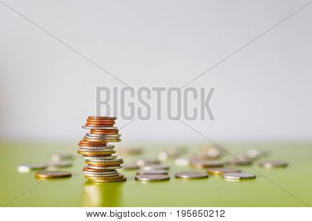 Saving money concept preset by money coin stack selective focus