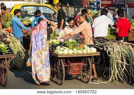 MUMBAI, INDIA - November 11 2017: Street sellers selling vegetables in Mumbai, India