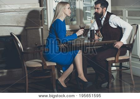 Couple In Love Drinking Red Wine In Restaurant