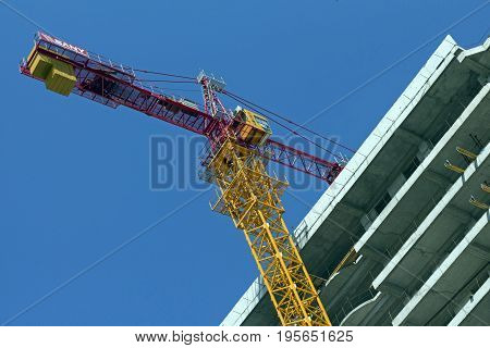 Construction crane on top of a new building being built in Yerevan,Armenia.