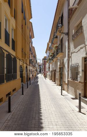 Narrow street in the old town of Lorca. Murcia province southern Spain