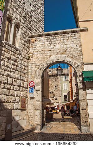 Vence, France - July 13, 2016. View of city portal in stones and wall in Vence, a stunning medieval town completely preserved. In Alpes-Maritimes department, Provence region, southeastern France