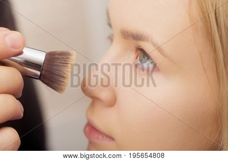 Girl Getting Powder On Face Skin With Makeup Brush