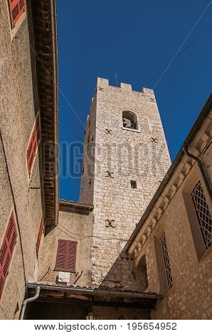 View of stone steeple tower next to church in Vence, a stunning medieval hamlet completely preserved. Located in the Alpes-Maritimes department, Provence region, southeastern France
