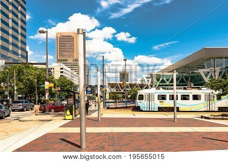 Baltimore Maryland USA - July 8 2017: Lightrail stop on Pratt Street in downtown Baltimore Maryland near the Inner Harbor.
