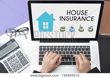 business hand using computer with protection house insurance policy page. concept accident prevention coverage.