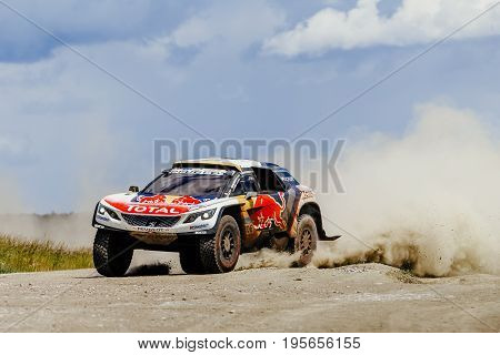 Filimonovo Russia - July 10 2017: rally car Peugeot driving on a dust road during Silk way rally