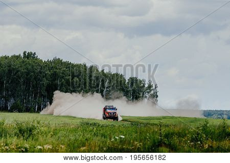 Filimonovo Russia - July 10 2017: truck rally car Renault driving on dust road among forest and grass during Silk way rally