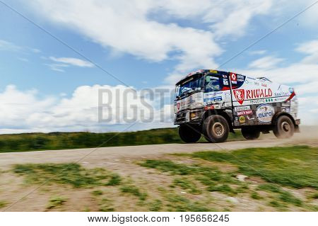 Filimonovo Russia - July 10 2017: blurred motion truck rally car Renault driving blue sky over him during Silk way rally