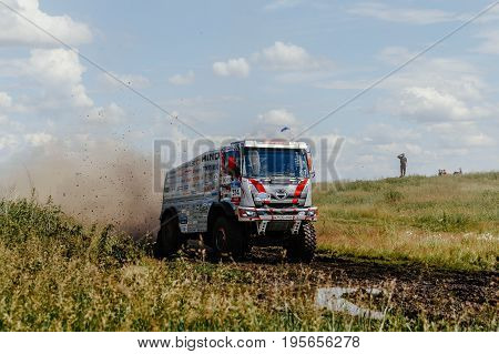 Filimonovo Russia - July 10 2017: truck rally car Hino driving on road splashes of dirt and water during Silk way rally