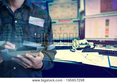 Double exposure of Engineer or Technician man in working shirt working with tablet in control room of oil and gas platform or plant industrial for monitor process business and industry concept.