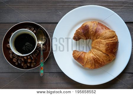 Light Morning Breakfast. Croissant And Cup Of Coffee Espresso