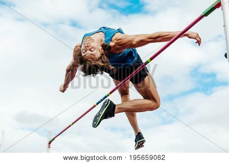 Chelyabinsk Russia - July 7 2017: successful attempt high jump male athlete during Ural Championship in athletics