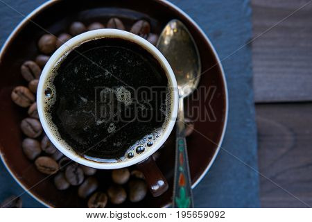 Closeup Aromatic Coffee Beans And Cup Of Coffee For Awaken