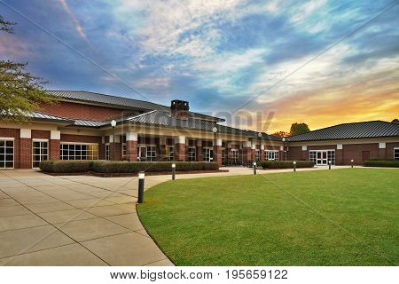 Generic Brick Office Executive, Recreational, Rec Center, Administrative Building Exterior with Landscaped Lawn, columns and street lights and chimney