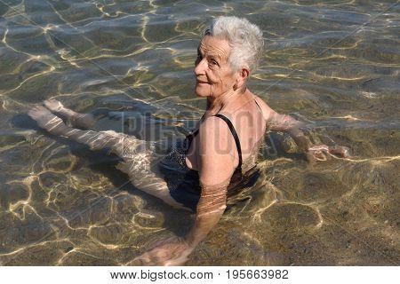 Older Woman Bathing In The Sea,