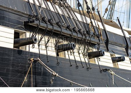 Baltimore Maryland USA - July 8 2017: Close up of cannons on the USS Constellation one of the historic ships docked in Baltimore's Inner Harbor. Built in 1854 this ship was the U.S. Navy's last sail-only warship.