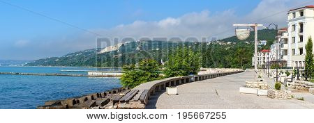 Balchik panoramic cityscape view of city quay with apartment buildings and houses on the hills of black sea coast in Bulgaria.