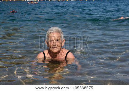 A senior woman having a bath in the sea