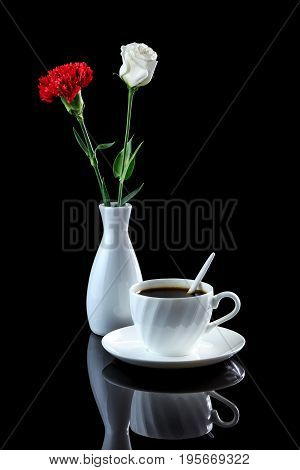 Composition With Cup Of Coffee, White Rose And Red Carnation On A Black Reflective Background