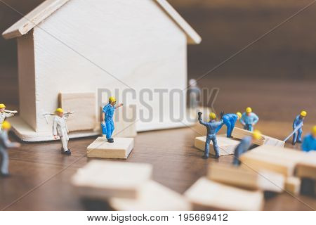 Miniature Workers Team Build A Wooden House